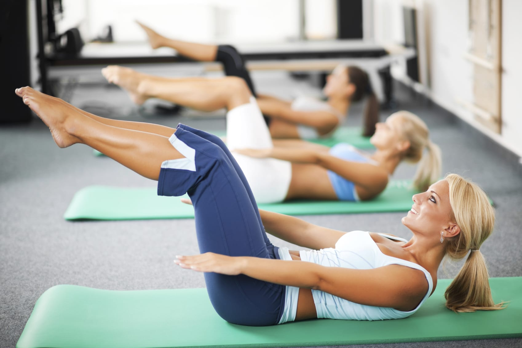 female-pilates-instructor-taking-a-class
